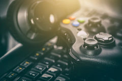 Gaming game play video on tv or monitor. Gamer concept. Fun gamepad video console gaming game play gamer player headset earphones keyboard concept - stock image Royalty Free Stock Image