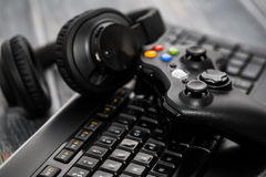 Gaming game play video on tv or monitor. Gamer concept. Fun gamepad video console gaming game play gamer player headset earphones keyboard concept - stock image Stock Images