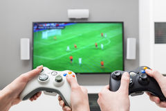 Gaming game play video on tv or monitor. Gamer concept. Gaming game play tv fun gamer gamepad guy controller video console playing player holding hobby playful royalty free stock images