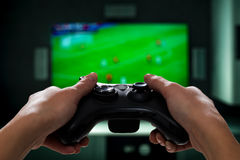 Gaming game play video on tv or monitor. Gamer concept. Gaming game play tv fun gamer gamepad guy controller video console playing player holding hobby playful royalty free stock photography