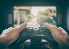 Gaming game play video on tv or monitor. Gamer concept. Royalty Free Stock Photography