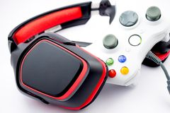 Gaming. Headset with mic and controller for video games Royalty Free Stock Photography