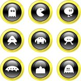 Gaming icons. Collection of cute gaming icons set on black glossy buttons Stock Photography