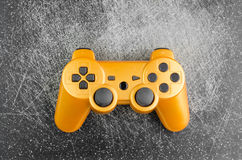 Gaming Joystick. Orange Gaming Joystick On Dark Scratched Background royalty free stock images