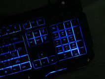 The gaming keyboard shines with multi-colored keys. For the convenience of players royalty free stock image