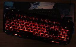 The gaming keyboard shines with multi-colored keys. For the convenience of players stock photos