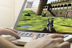 Gaming on a laptop Royalty Free Stock Photos