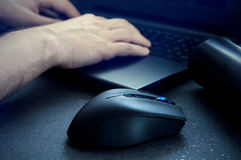 Gaming mouse with man using computer at night. Royalty Free Stock Photo