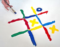 Gaming with noughts and crosses. Hand painting the game noughts and crosses Stock Image