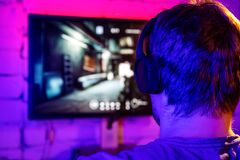 Free Gaming On Pc - Man Playing Online Multiplayer Shooter Game. Back View Stock Image - 178198941