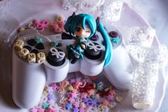 Gaming PlayStation vita tv character cartoon hatsune miku anime. Rythmgame glitter sweet gamer stars pink VOCALOID girl plate lace dessert colorful Royalty Free Stock Photo