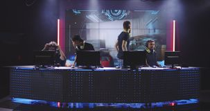 Gaming team losing a match at a tournament. Full shot of a team losing a match at a gaming tournament stock footage