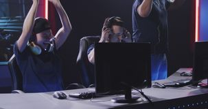 Gaming team winning match at tournament. Medium shot of a team winning a match at a gaming tournament stock footage