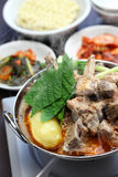 Gamjatang, pork bone and potato soup, korean cuisine. Simmering on the portable gas stove royalty free stock images