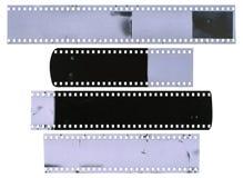 Gamla, använda, dammiga och skrapade remsor för celluloidfilm Fotografering för Bildbyråer