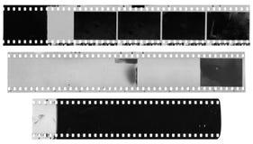 Gamla, använda, dammiga och skrapade remsor för celluloidfilm Arkivbild
