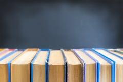 Gamla böcker på svart bakgrund Royaltyfri Foto