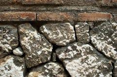 Gamla bakgrunder för textur för yttersidor för stenvägg, textur 16 Arkivfoton