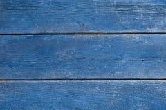 Gamla blått riden ut wood bakgrund Arkivbilder
