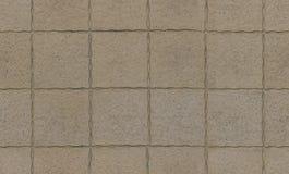 Gamla bruna sandstengolvtegelplattor Arkivbild