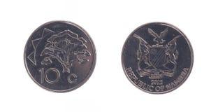 Gamla 10 dollarcent mynt, namibisk valuta Royaltyfri Bild