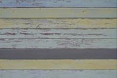 Gamla färgrika blått, guling och grå trävägg fotografering för bildbyråer