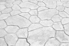 Gamla grå färger stenar gångbanan för bakgrund eller textur i naturmodeller royaltyfri foto