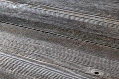 Gamla gråa träbräden som en bakgrund royaltyfri fotografi