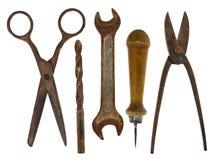 Gamla isolerade hjälpmedel: sax drillborr, skiftnyckel, syl, sax för mig Royaltyfria Foton