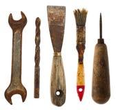 Gamla isolerade hjälpmedel: spatel drillborr, skiftnyckel, syl, borste Royaltyfri Foto