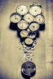 Gamla klockor och delarna Fotografering för Bildbyråer