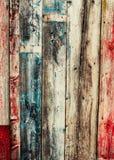 Gamla kulöra träplankor, knäckt målarfärg Arkivfoton