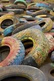 Gamla målade gummihjul Royaltyfri Fotografi
