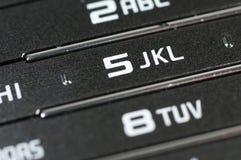 Gamla mobiltelefonnummer och siffror stänger sig upp Fotografering för Bildbyråer