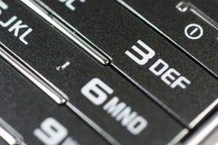 Gamla mobiltelefonnummer och siffror stänger sig upp Arkivbild