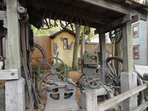 Gamla och lantliga kugghjul Arkivbilder