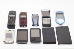 Gamla och nya mobiltelefoner, smartphone Royaltyfria Foton