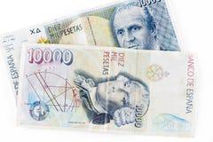 Gamla pappers- pengar för Spanien tappning som isoleras på en vit bakgrund Arkivbild