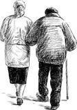Gamla par på en gå Arkivbild
