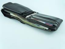 Gamla plånbokpengar Arkivfoton