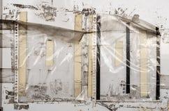 Gamla plast- muffar på en vägg Arkivbild