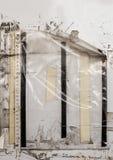 Gamla plast- muffar på en vägg Arkivfoto