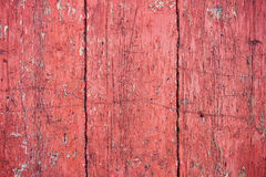 Gamla röda träväggplankor Arkivfoto