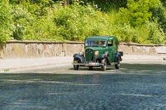 Gamla retro tagande deltagande för bilVOLVO AMASON 121 i loppLejonet Fotografering för Bildbyråer