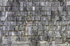 Gamla singlar för wood hus Arkivbilder