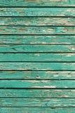 Gamla sjaskiga träplankor med sprucken målarfärg, retro wood bakgrund Royaltyfri Foto