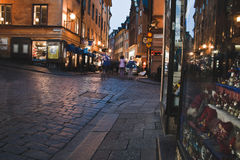 Gamla Stan. Shops and tourists in Gamla Stan, the old town of Stockholm, at night Stock Photos