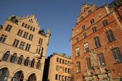 Gamla Stan Stockholm. Buildings in Gamla Stan, the old part of Stockholm, tower over the visitor Stock Images