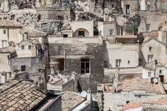 Gamla stenhusbyggnader och forntida italiensk by i Matera i Italien Royaltyfri Fotografi