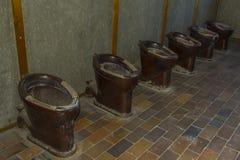 Gamla toaletter i den Dachau koncentrationsläger, Tyskland Fotografering för Bildbyråer